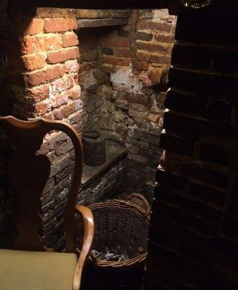 The centuries-old building is packed full of great features. This cute little cubbyhole sits at the left hand side of the fire.