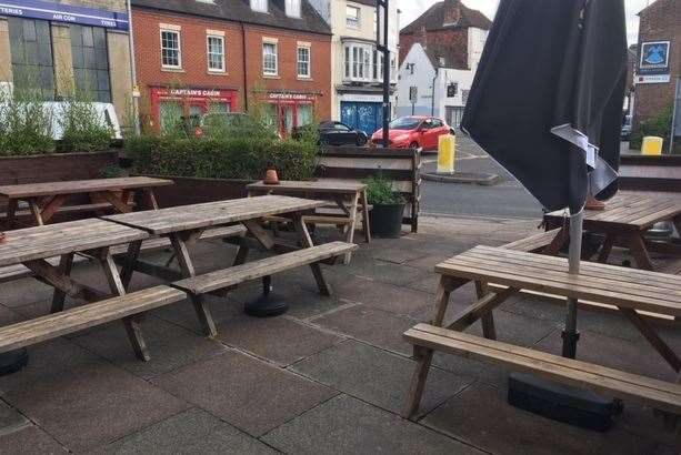 The outside seating area at the side of the pub