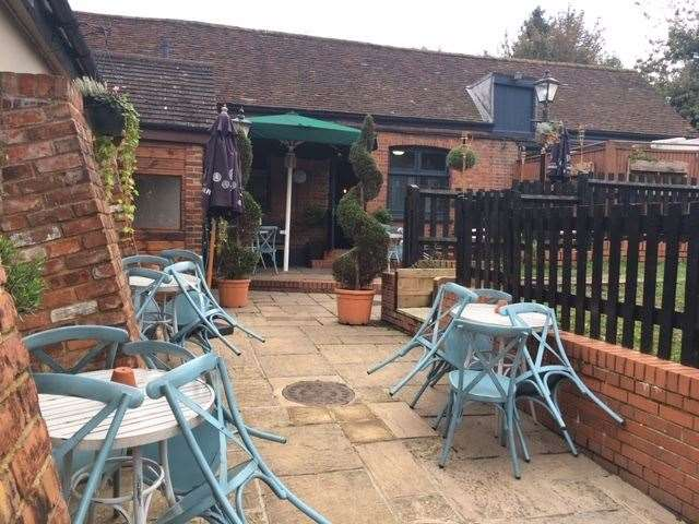 There are plenty of chairs and tables available for dining outside when the weather allows