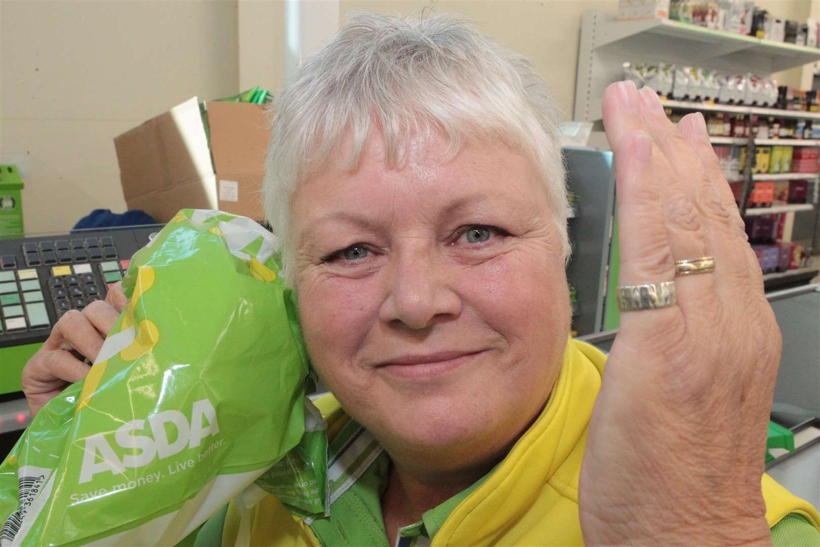 Checkout assistant June Cook is reunited with her old wedding ring that slipped off from her little finger while serving a customer at Asda on Pier Road in Gillingham. Picture: John Westhrop