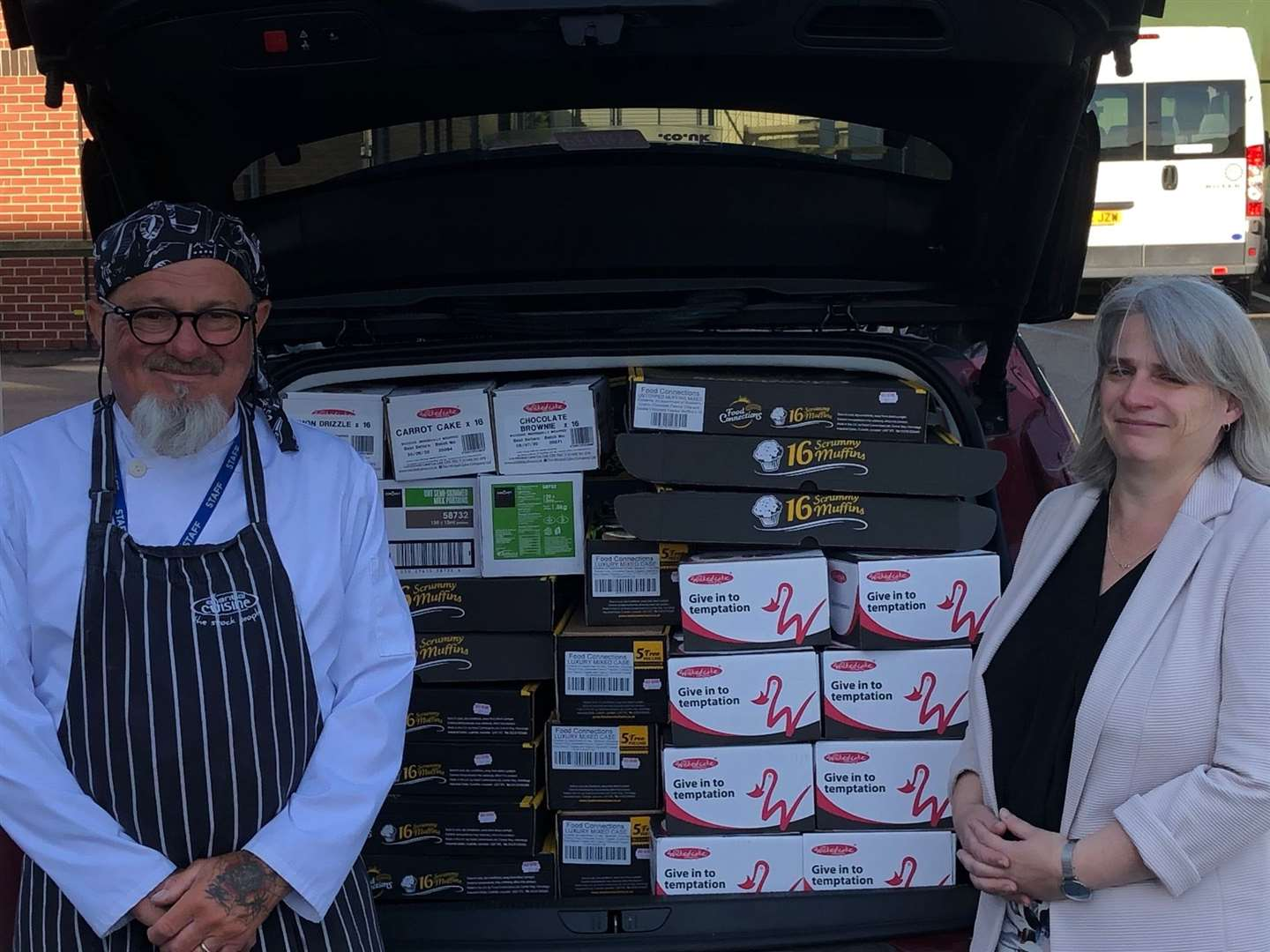 Restaurant manager Kevin Douglas and head teacher Tracey Savage with some of the donated items