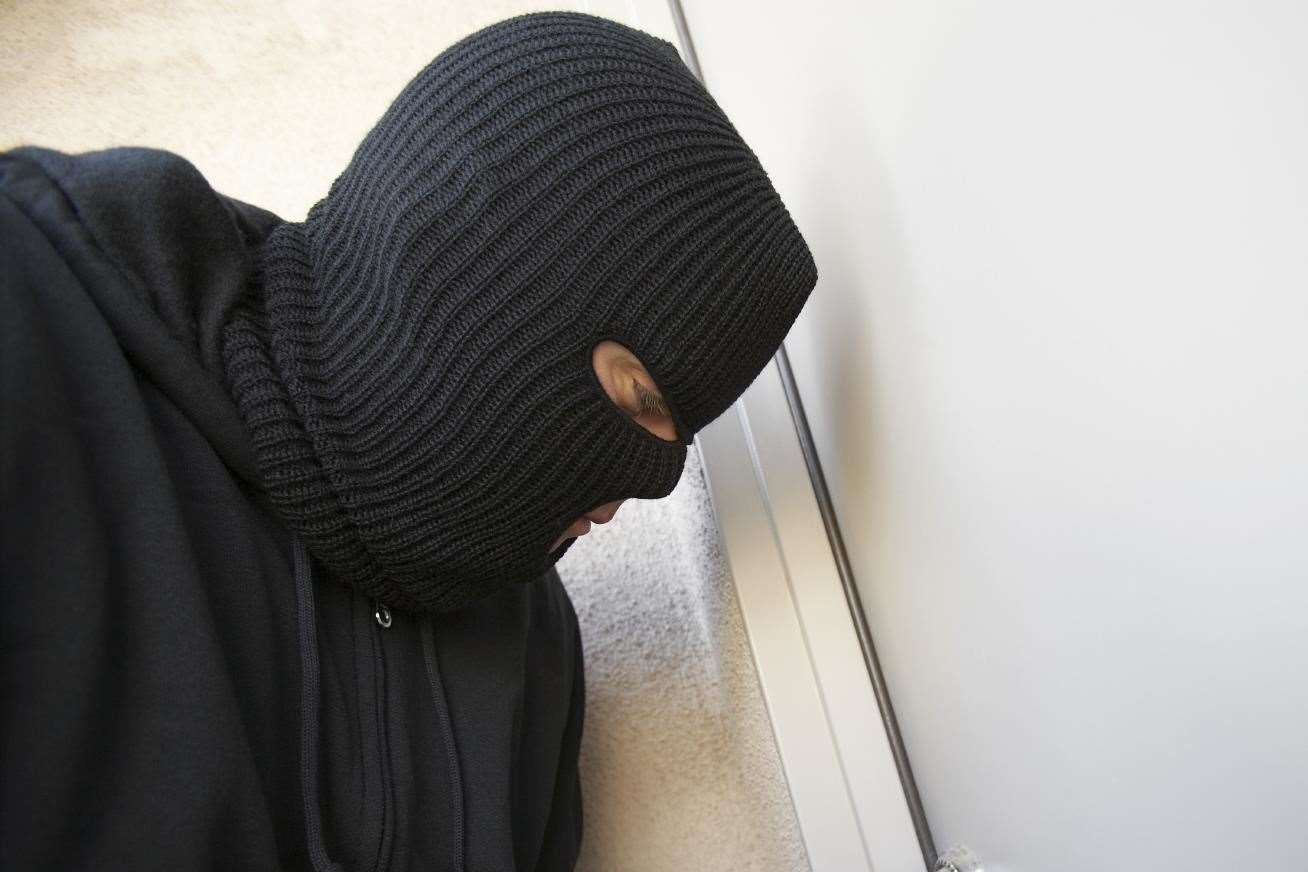 The assailant was dressed in black.  Stock photo