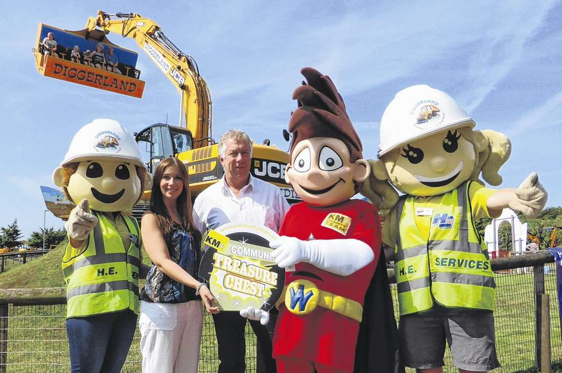 Sherene Garvin-Mack and Andy Ballantyne of Diggerland join Wowzer the KM Walk to School mascot to celebrate the attraction supporting KM Treasure Chest. Watched by Dougie and Dottie the Diggerland mascots.