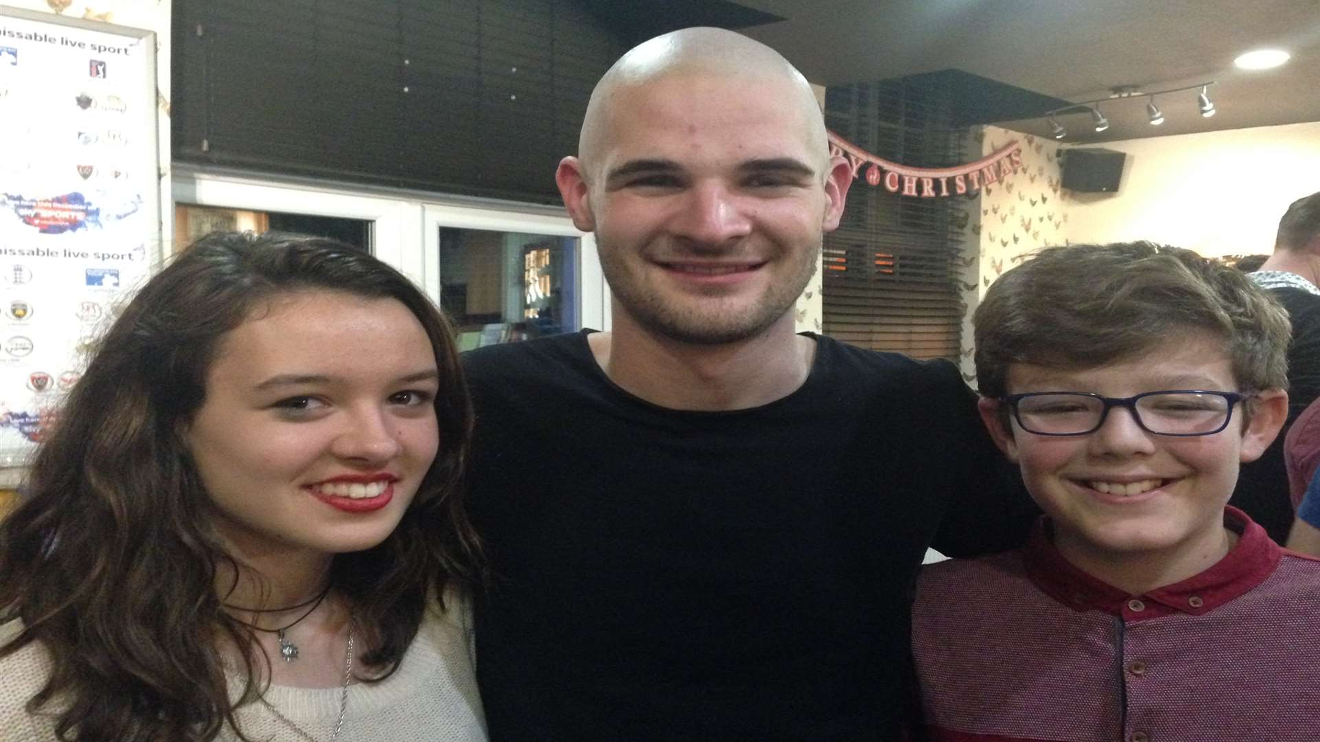 Jon Harris after the head shave with siblings Sarah and Daniel Colyer