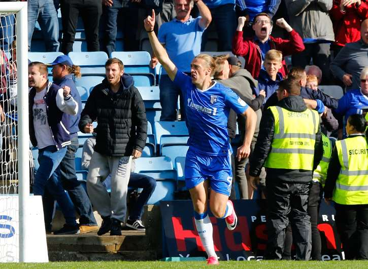 Tom Eaves celebrates the goal that clinched a win for Gillingham over Charlton Picture: Andy Jones