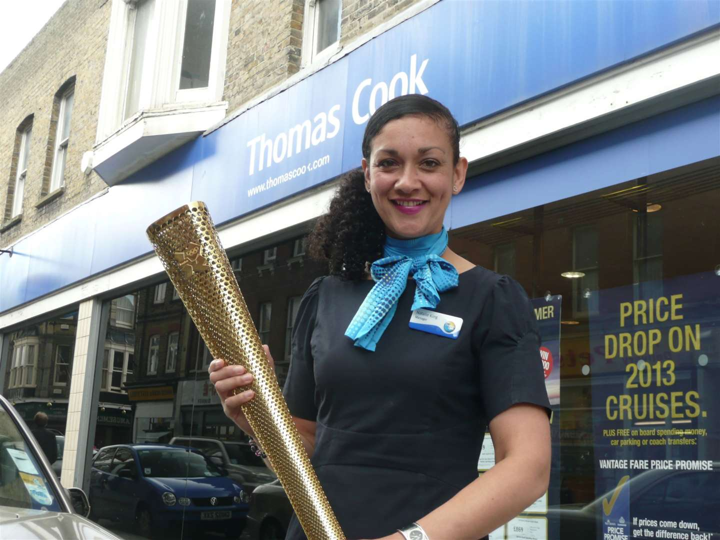 Natalie King, manager of Thomas Cook in Dover, with her Olympic torch