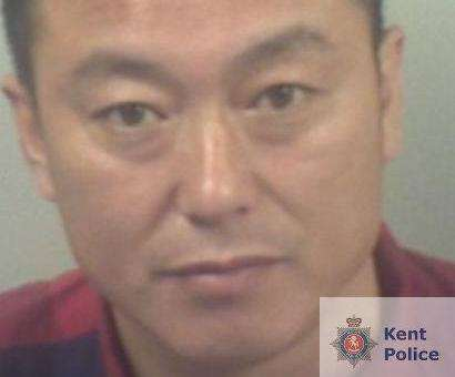 Hongnan Wu has been jailed for 14 months along with his wife for running a brothel. Picture: Kent Police