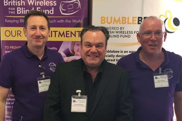 Shaun Williamson, joins British Wireless for the Blind Fund staff Saul Watson and Simon Parsons at the Rotary regional conference.