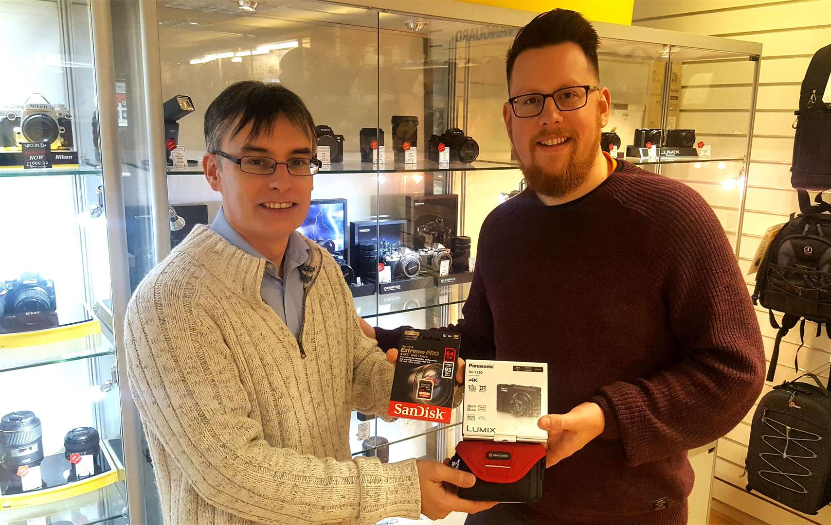 Yan Cowley (left) of the Canterbury Camera Centre presents the prize Panasonic Lumix to winner Daniel Russell