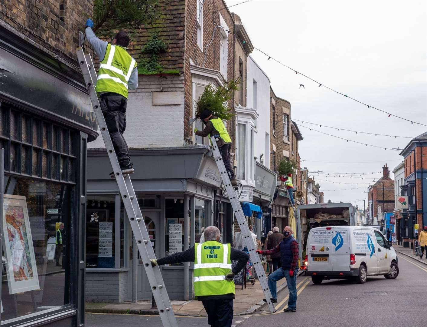 Volunteers from the Chamber and Deal Rowing Club erected free trees around the town Picture: Smugshot