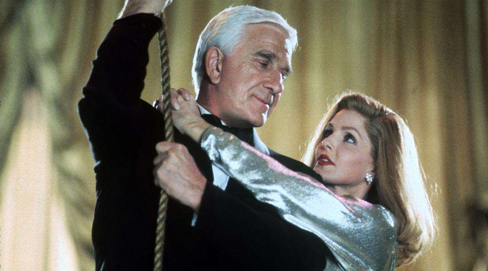Leslie Nielsen and Priscilla Presley in Naked Gun 33 and a third