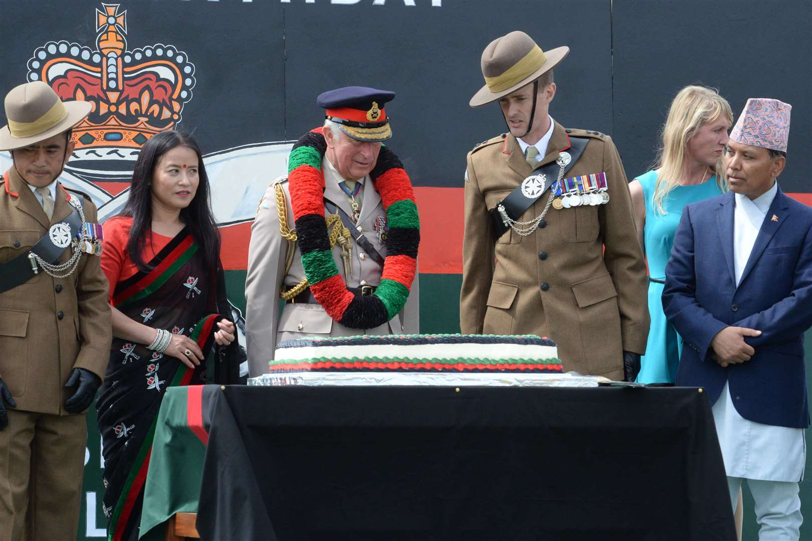The Prince cuts the 25th anniversary cake. Picture: Chris Davey