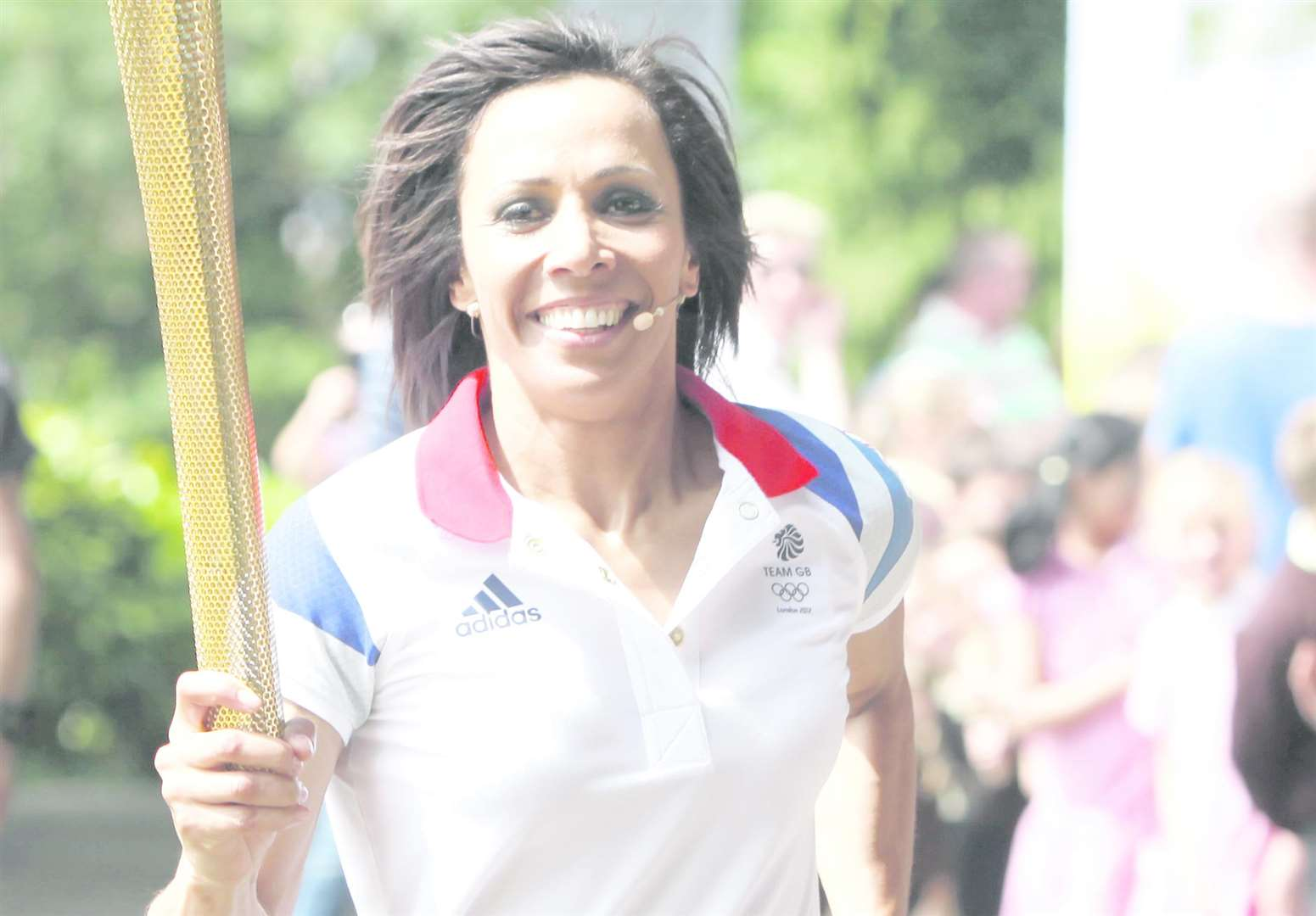 Dame Kelly Holmes with the Olympic Torch at Tonbridge Castle. Picture: Matthew Walker