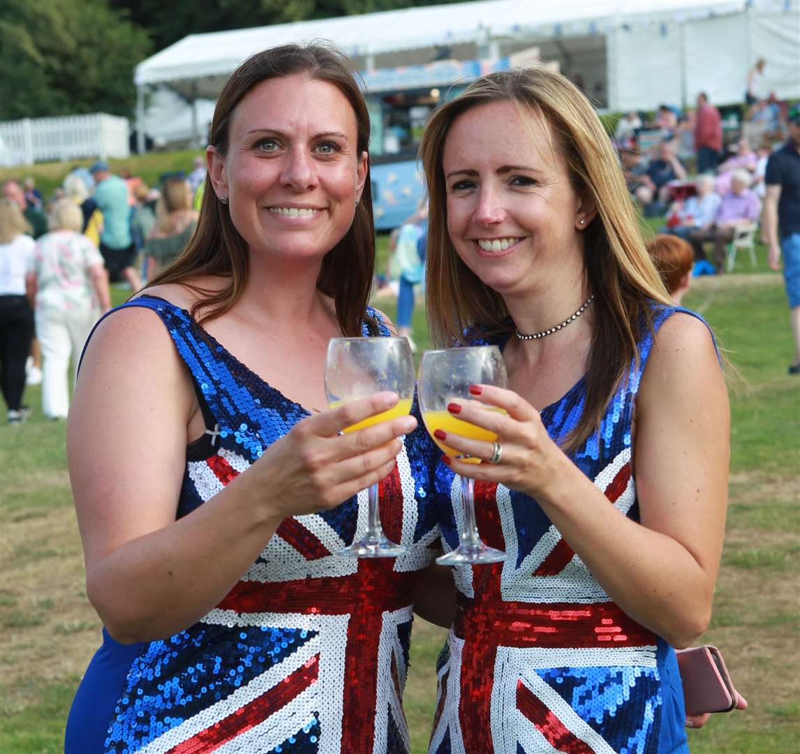 From left, Suzanne Lake and Kelly Lywood, from Sittingbourne in union jack dresses at Leeds Castle Classical Concert. Picture: John Westhrop