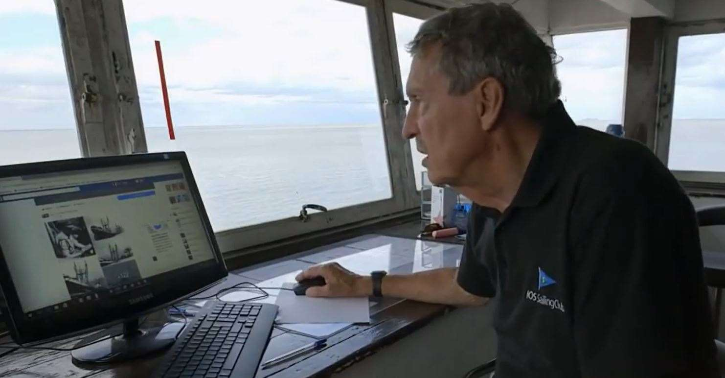Wreck-watcher Tim Bell in the control tower of the Isle of Sheppey Sailing Cub checking the masts of the Sheppey bomb ship the SS Richard Montgomery. Picture: NDR