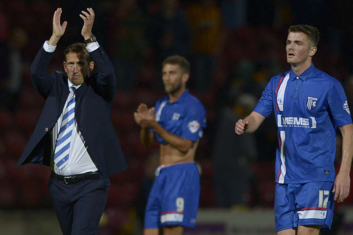 Gills boss Justin Edinburgh salutes the travelling fans at BradfordPicture: Barry Goodwin