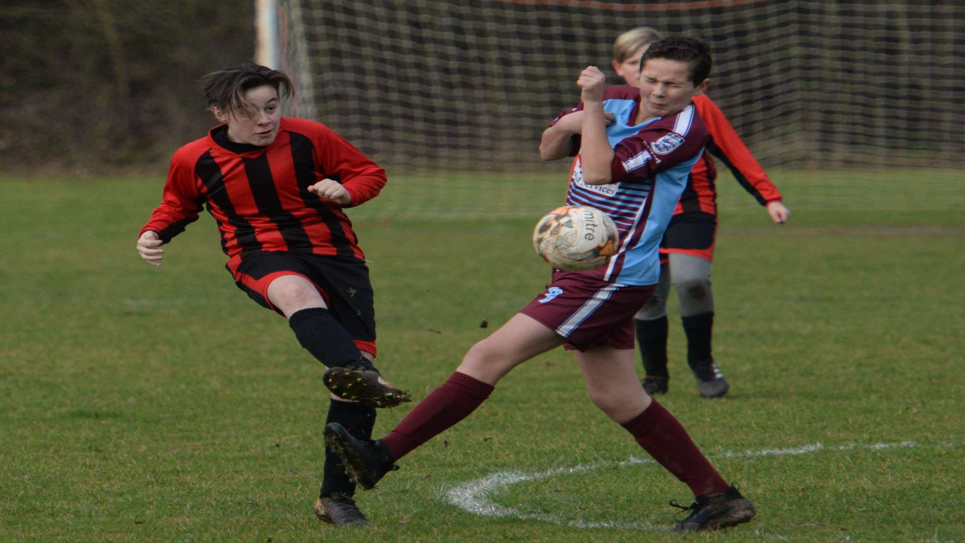 Meopham Colts under-13s and Wigmore Youth get stuck in Picture: Chris Davey