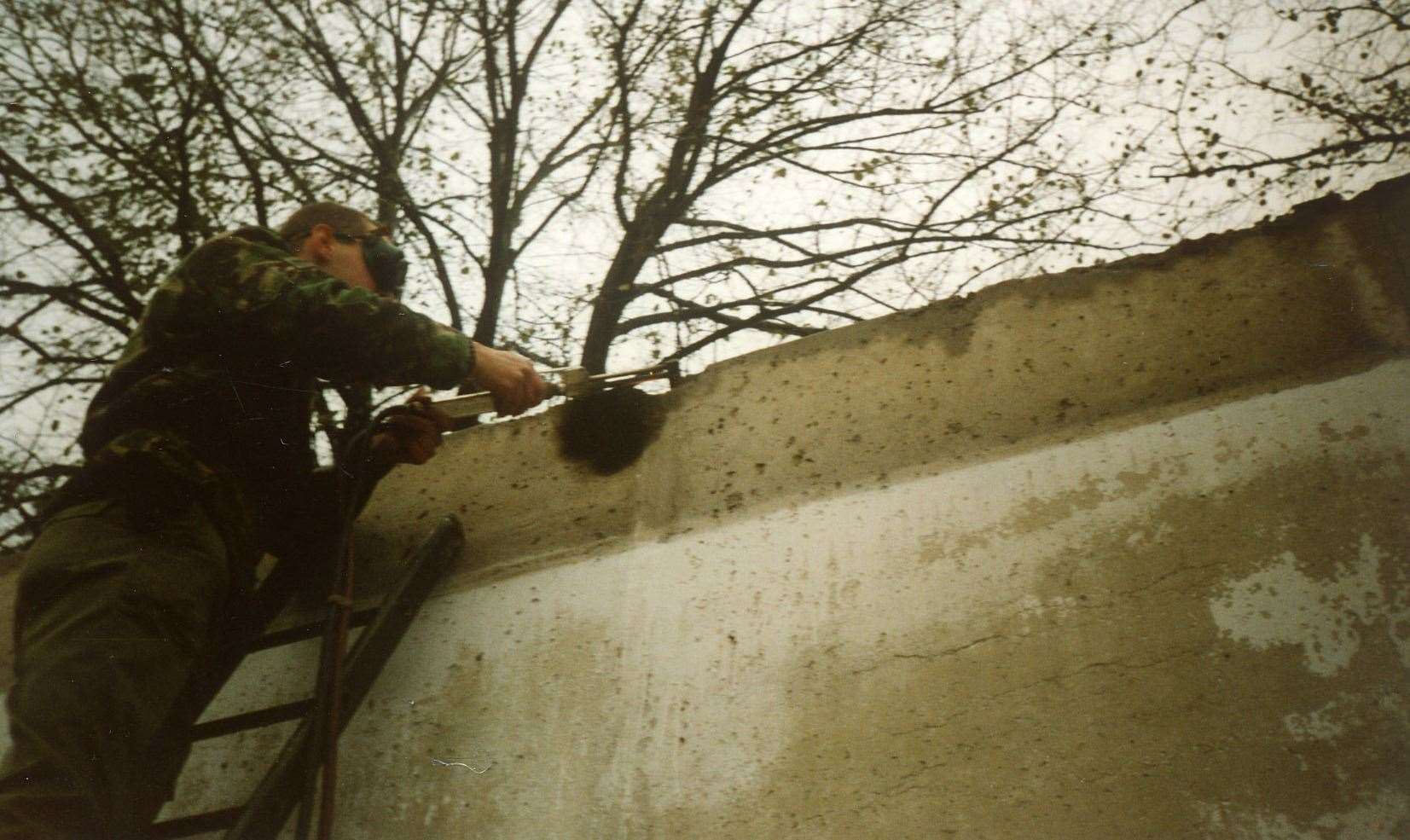 Sapper Jason Farnell at work on the Berlin Wall