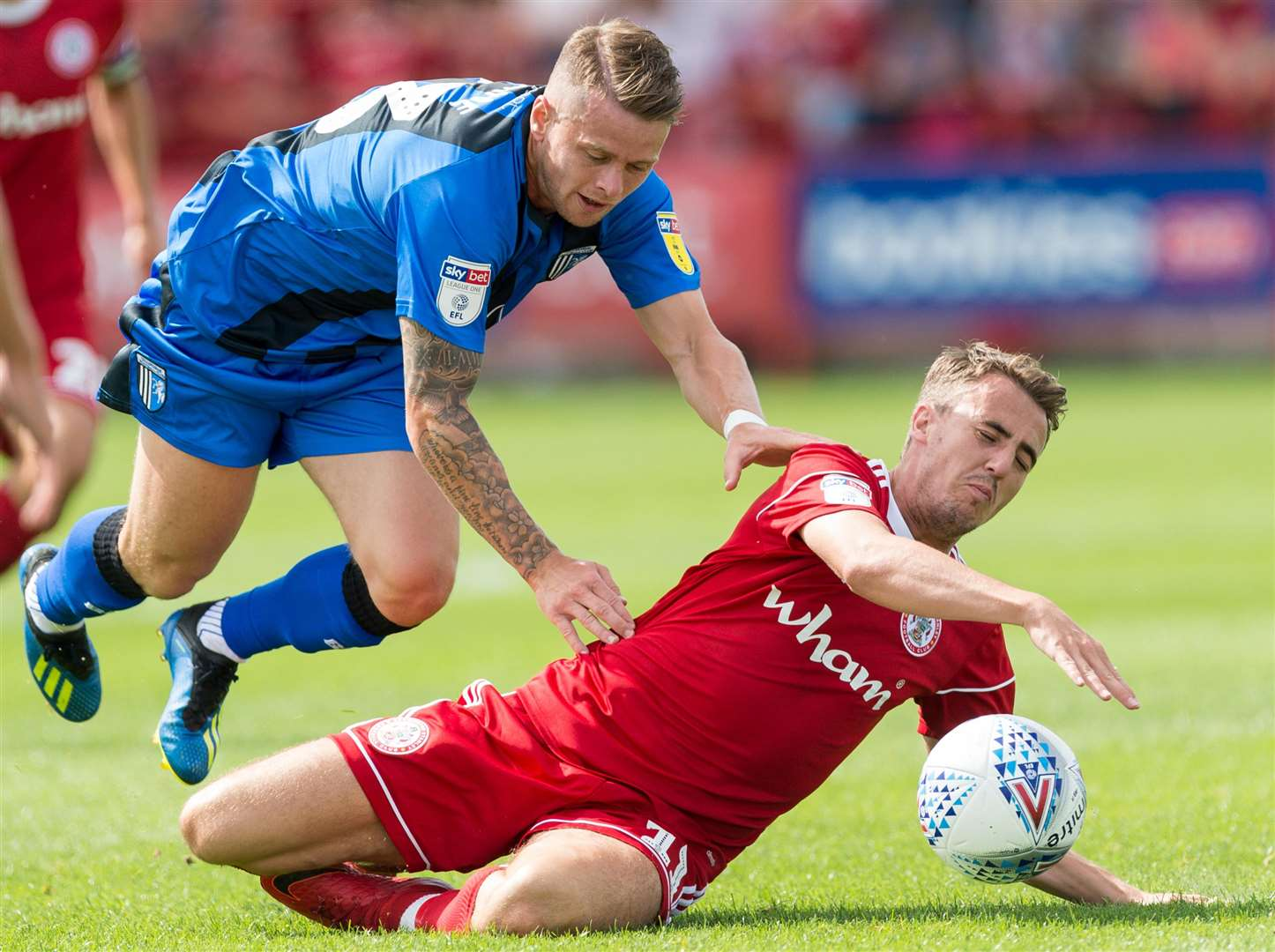 Gillingham's Mark Byrne challenges with Accrington's Sean McConville. Picture: Ady Kerry