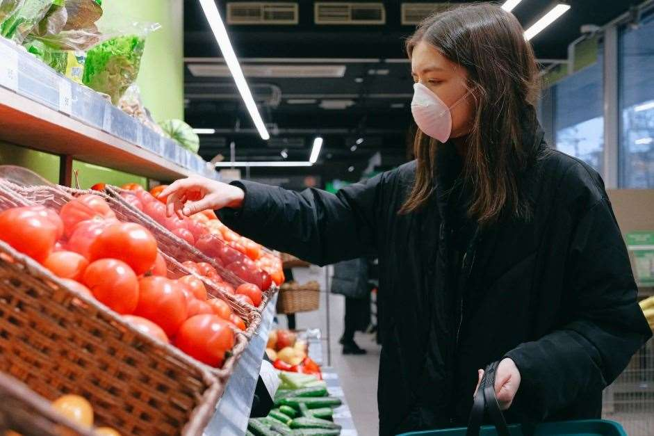 A young woman wearing a mask while shopping. Stock picture