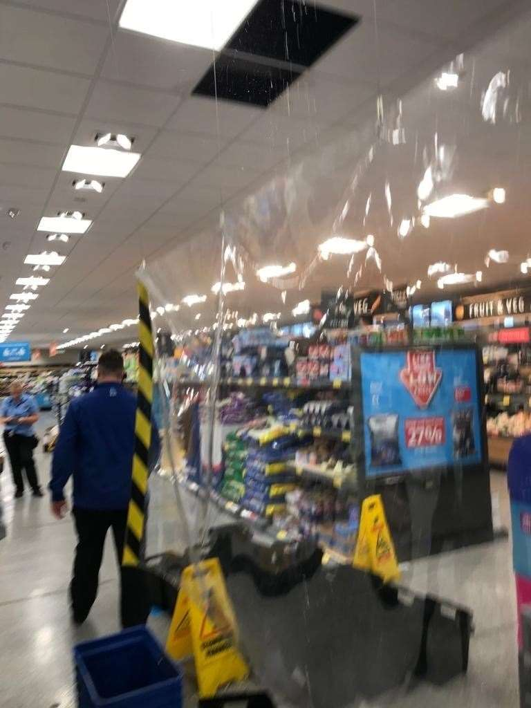 Shoppers were evacuated from the store as rain leaked through the roof causing ceiling tiles to fall