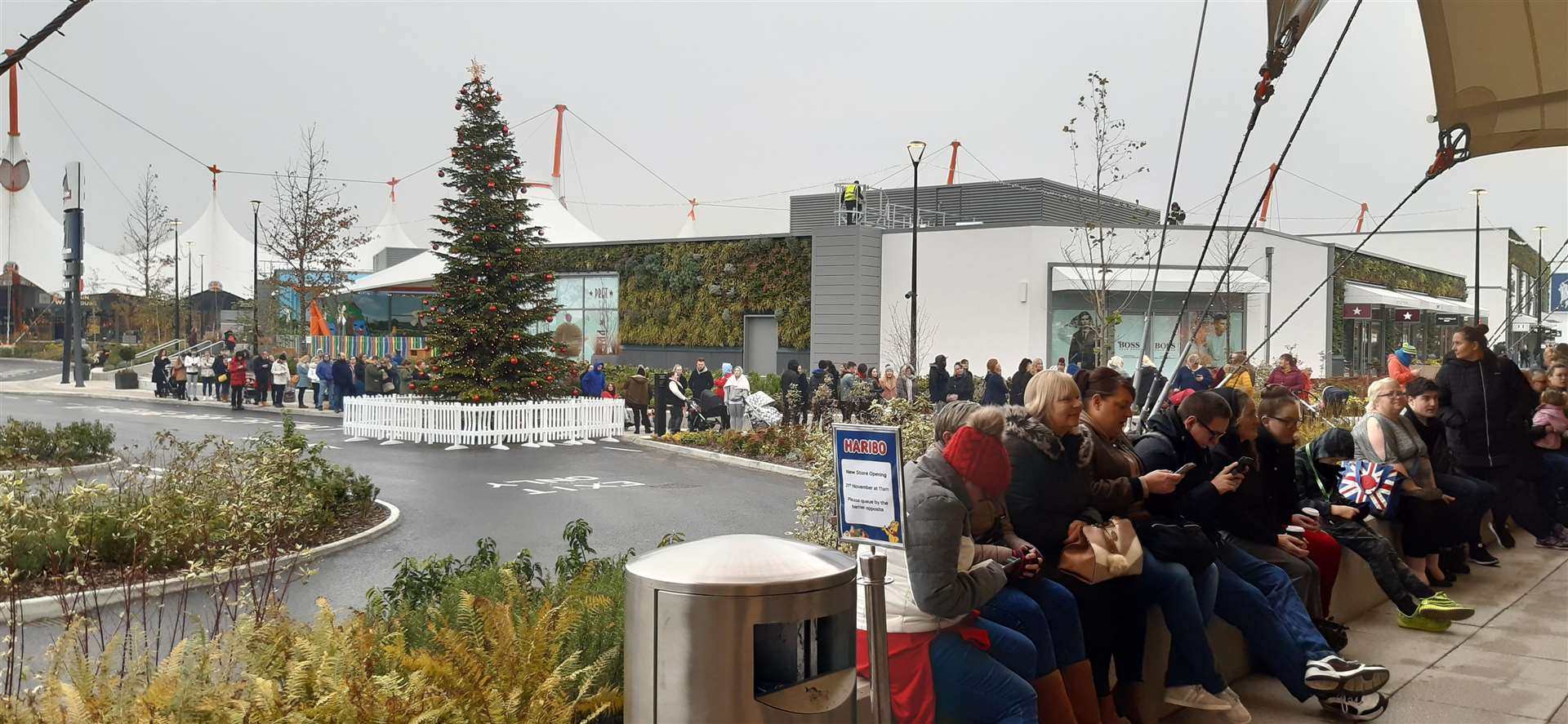 Huge queues have formed ahead of the 11am opening of the new Haribo store in the Ashford Designer Outlet