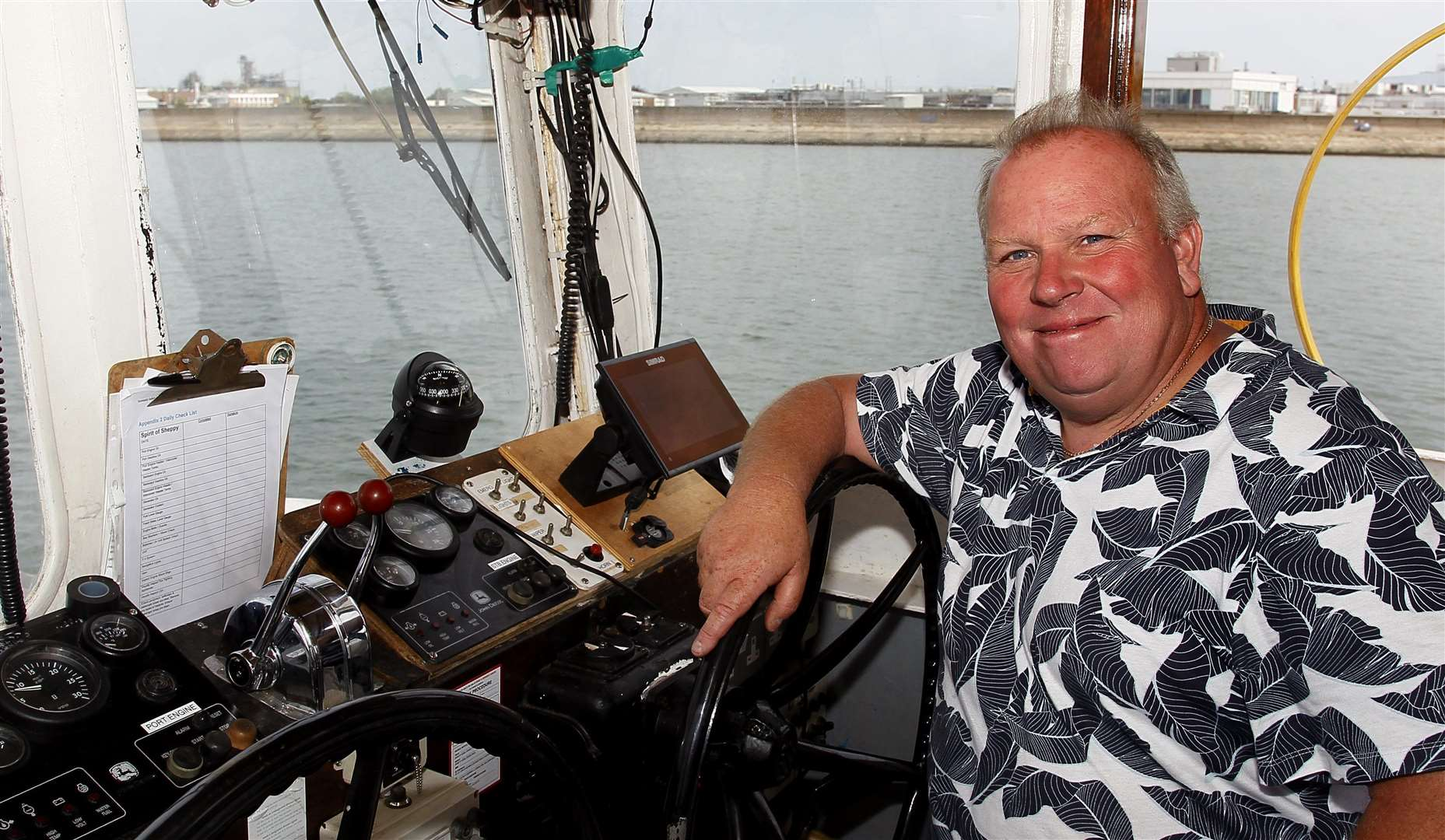 Dave Wilcock in the wheelhouse of the Spirit of Sheppey in Queenborough. Picture: Sean Aidan