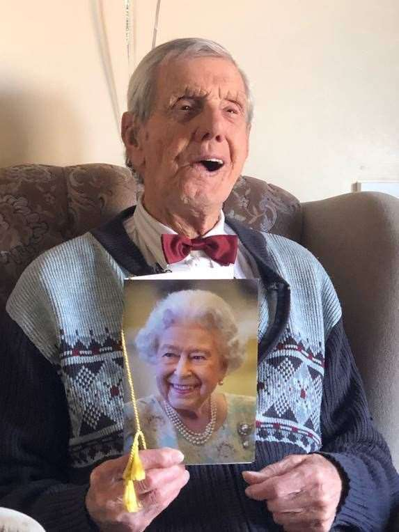 Charlie Pallett with his card from The Queen