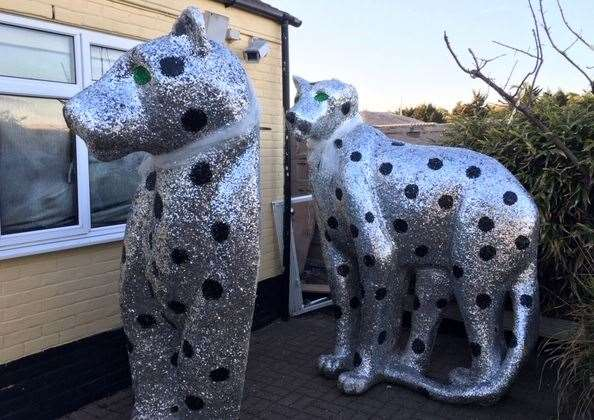 Two giant shiny silver cats, to be found at the back of the pub