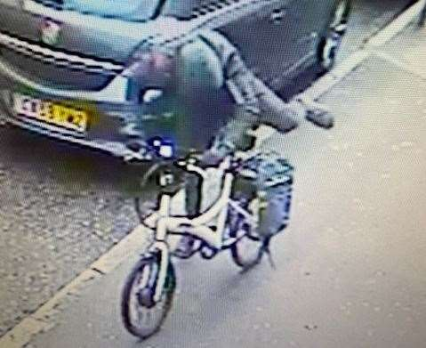 The hooded thief was spotted on CCTV with the bike