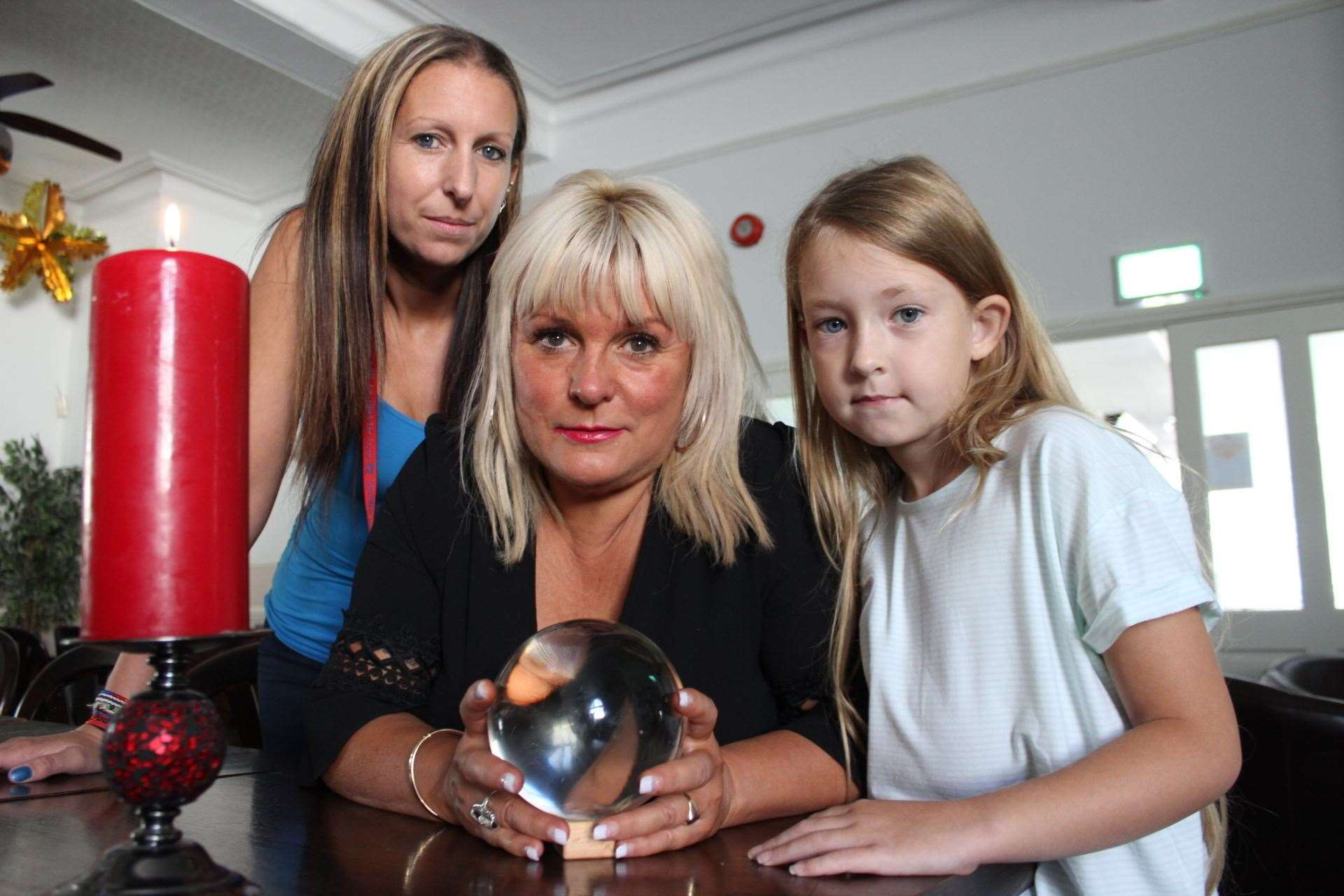 Sheppey medium Charlotte Clark used her crystal ball to investigate spirits at the Royal Hotel, Sheerness, in 2017, pictured with manager Sarah Lewry and her daughter Jazmin, 8.