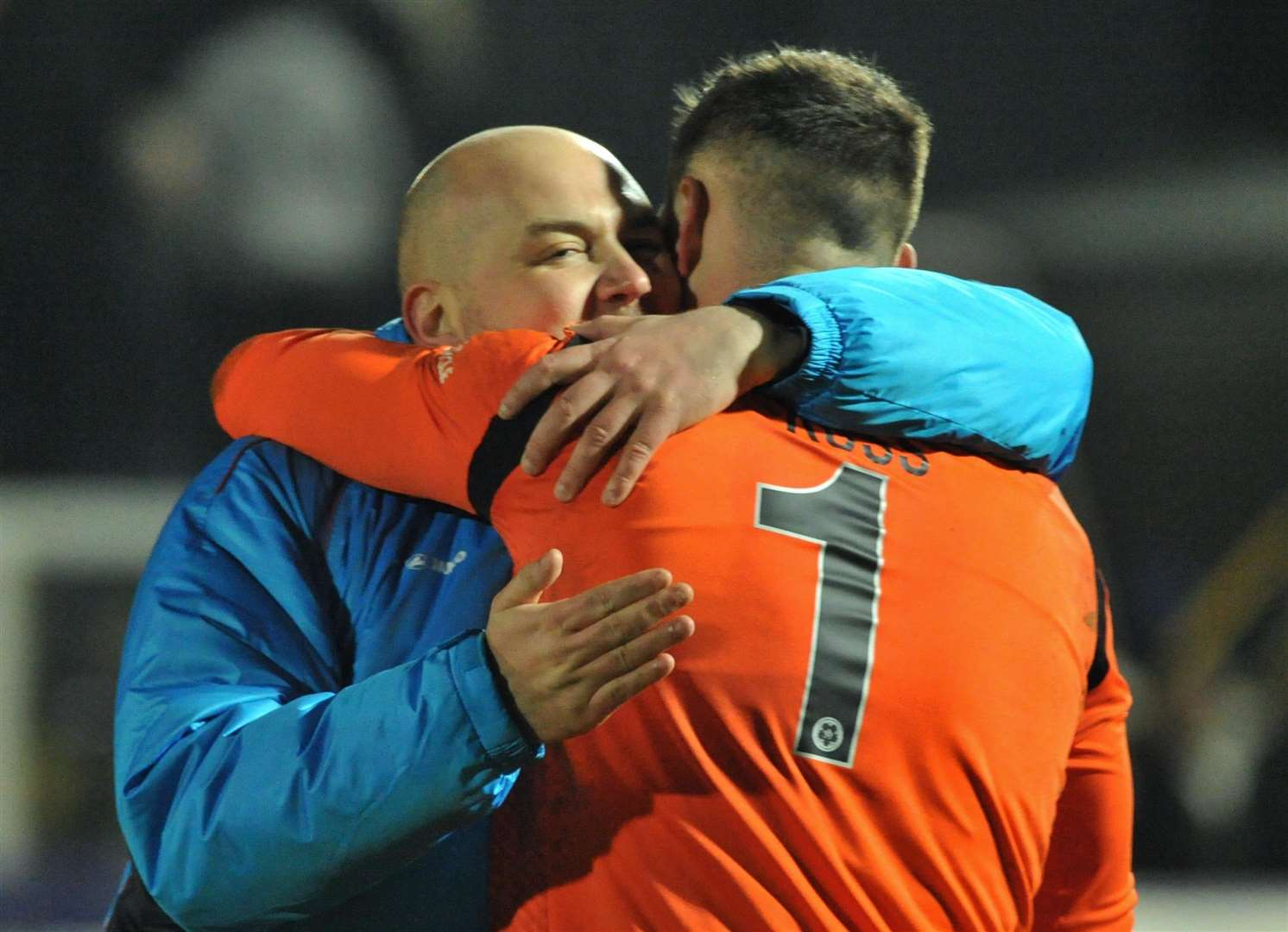 Caretaker boss Tristan Lewis embraces Ethan Ross after the final whistle at Hartlepool Picture: Steve Terrell