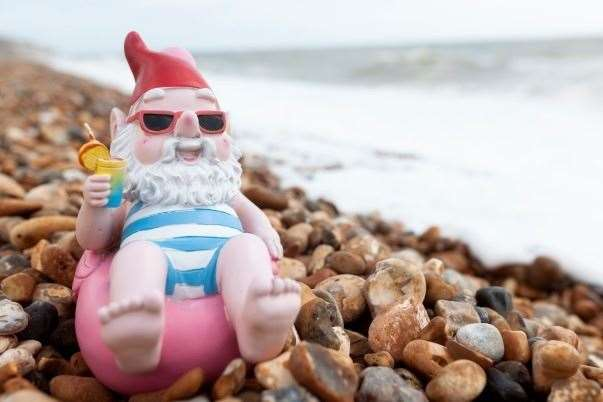 An Asda gnome relaxes by the sea outside the Wilson's home. Picture: Asda