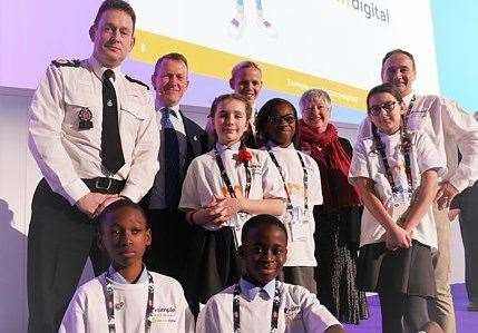 Children and senior police officers unveil the 'Dot Com' programme to thousands of teachers at Bett 2020