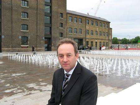David Bracey, director of The Fountain Workshop, in front of some of the water jets in Granary Square, Kings Cross