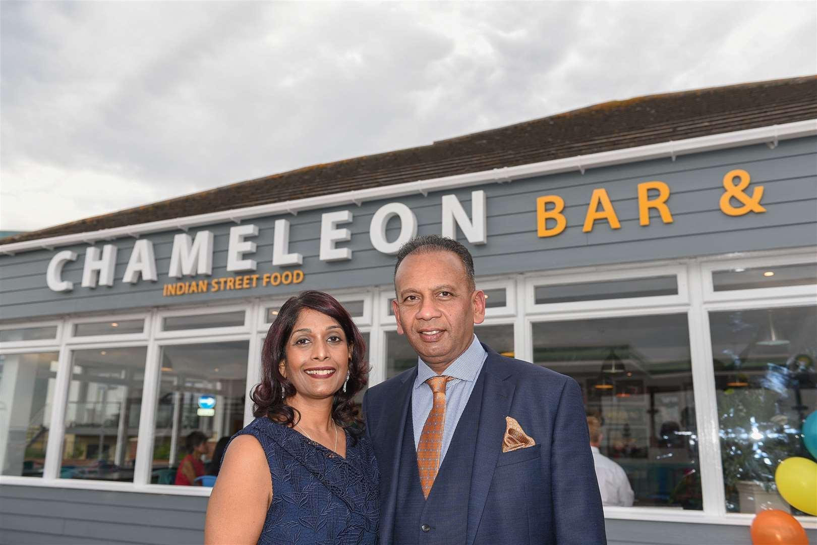 Mr Rajamenon has opened the Chameleon Bar & Grill in Hythe, pictured with wife Anusha