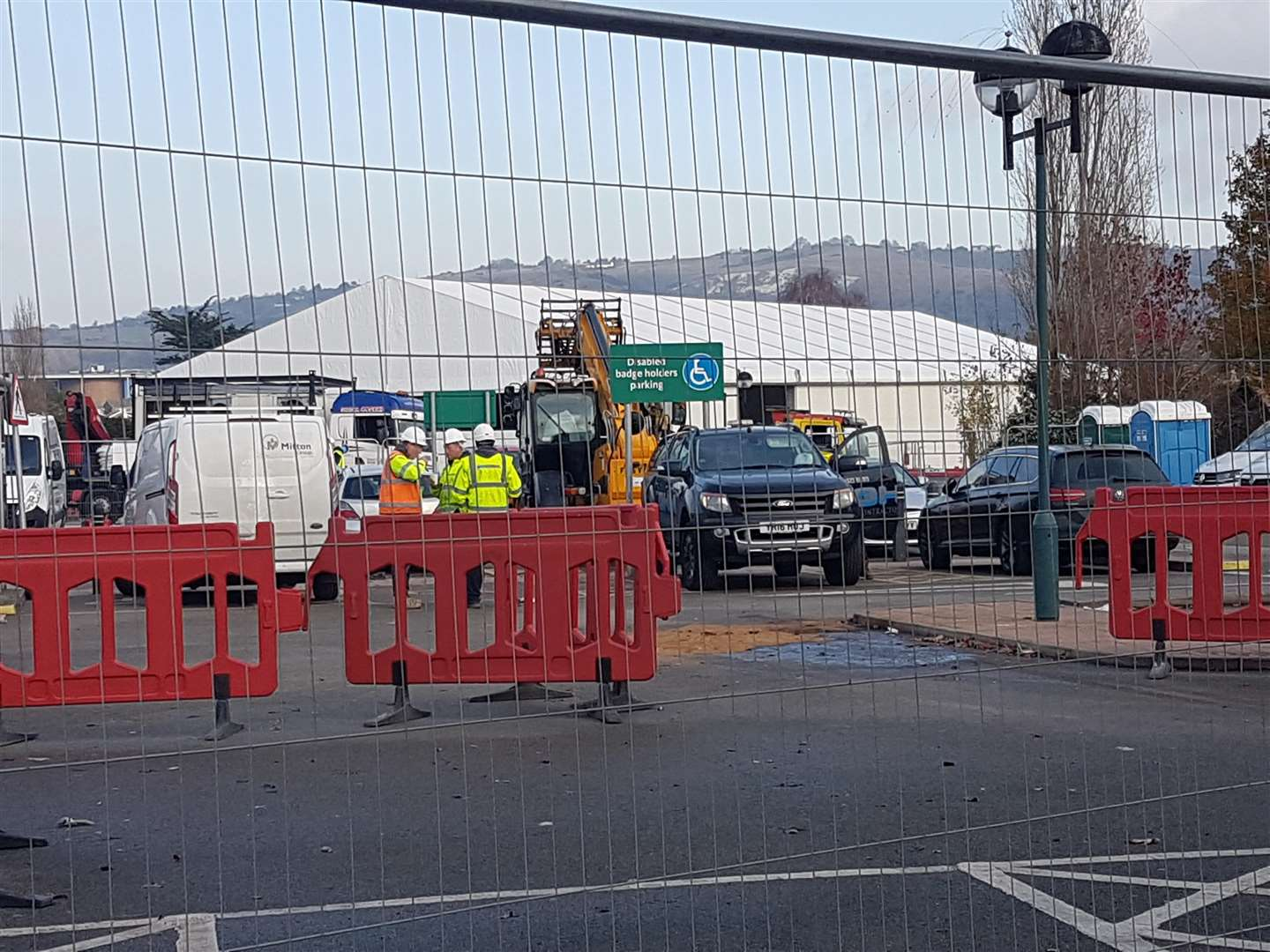 Builders working on the temporary Morrisons structure in Folkestone (5631572)