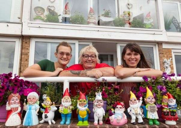 Janet Wilson and her daughters Adel and Karina with their collection of Asda gnomes. Picture: Asda