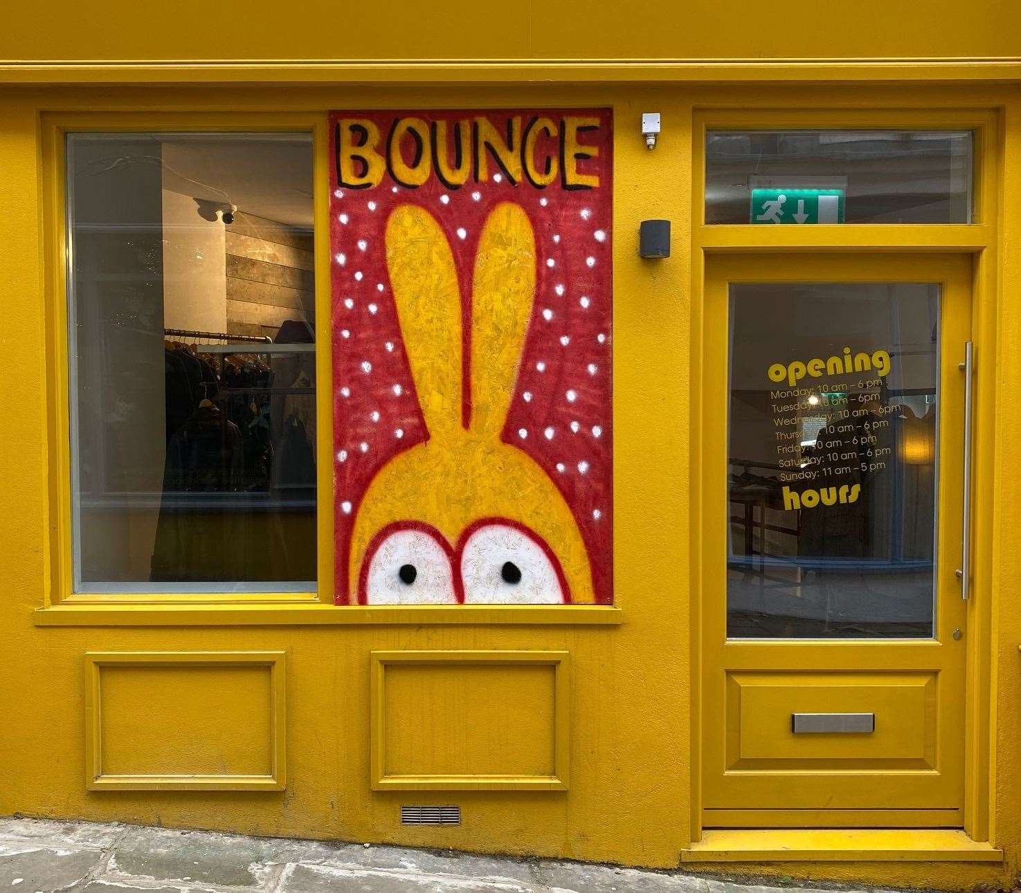 The owners of Bounce Vintage had their shop window smashed during the spree. They have since put boarding up, painted by artist Duncan Weston. Picture credit: Bounce Vintage