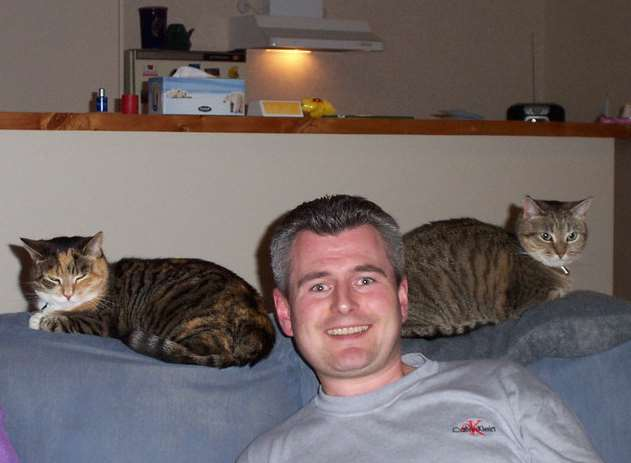 Richard Steven with his cats in New Zealand