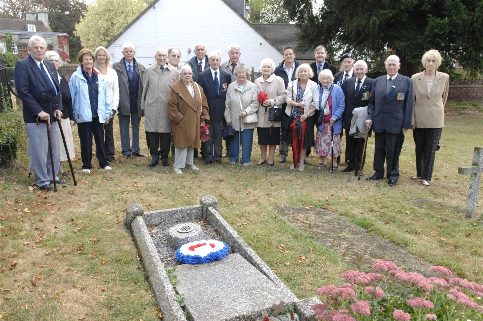 Family and friends at Squadron Leader David Maltby's grave