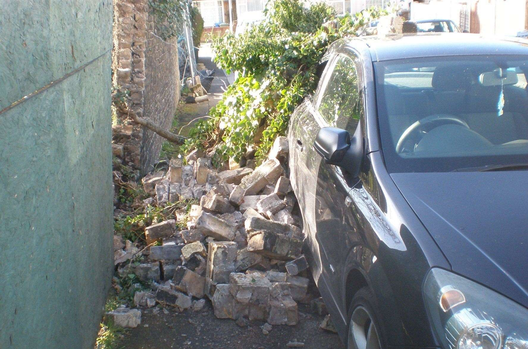 The wall collapsed on the car in Thomas Road, Sittingbourne. Picture: Ian Maggs