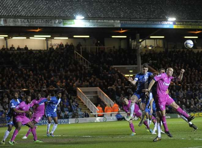 Adam Barrett (right) gets up well at London Road Picture: Ady Kerry