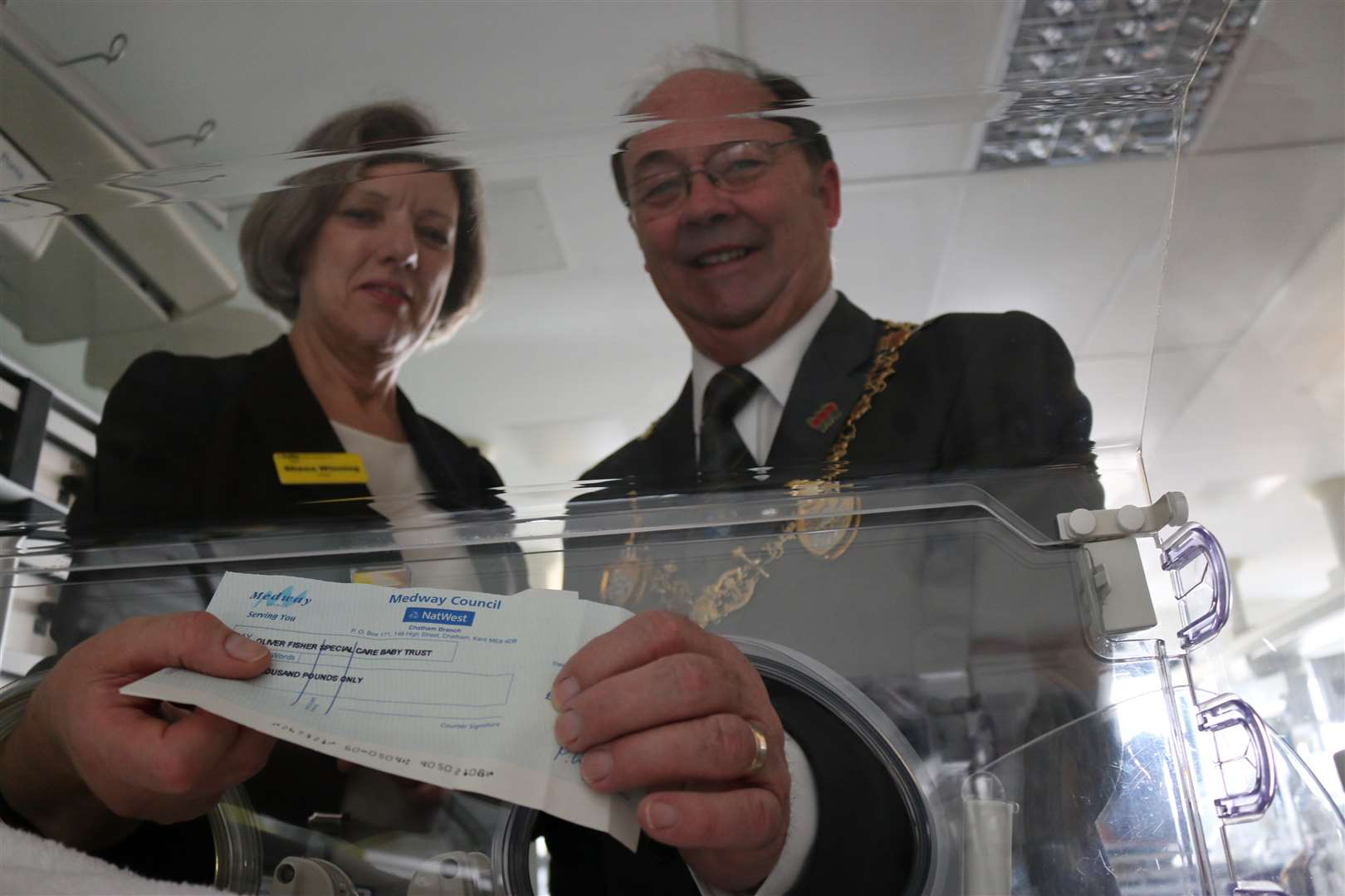 Mayor of Medway Cllr Barry Kemp giving a cheque to the Neo-natal unit, Medway Maritime Hospital