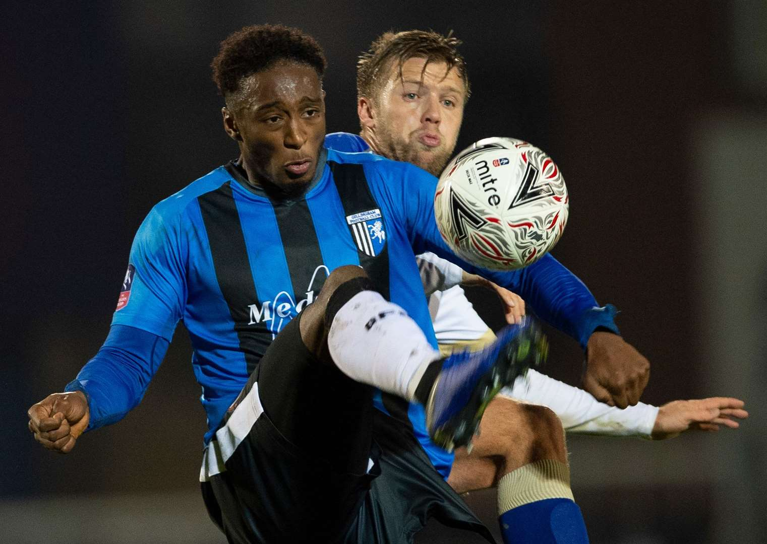 Gillingham's Brandon Hanlan comes under pressure from Nicky Featherstone. Picture: Ady Kerry