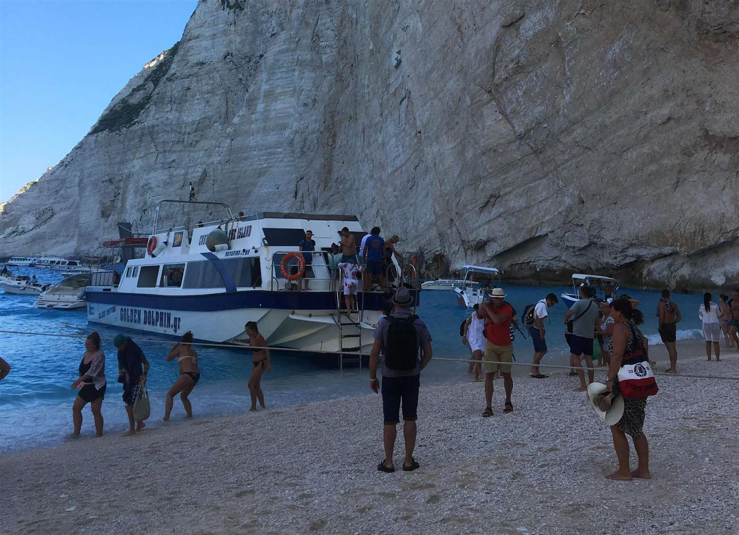 A boat transporting holidaymakers to the beach just minutes before the landslide