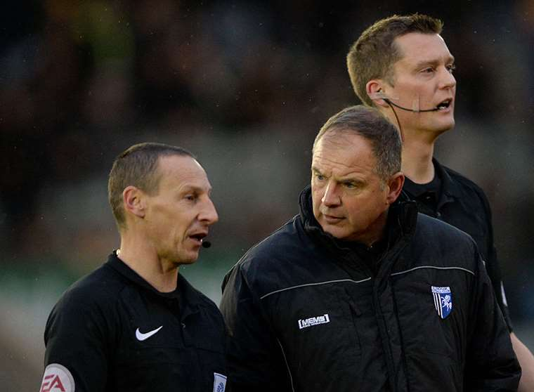 Gills boss Steve Lovell speaks to the match officials after his side were denied a goal Picture: Ady Kerry