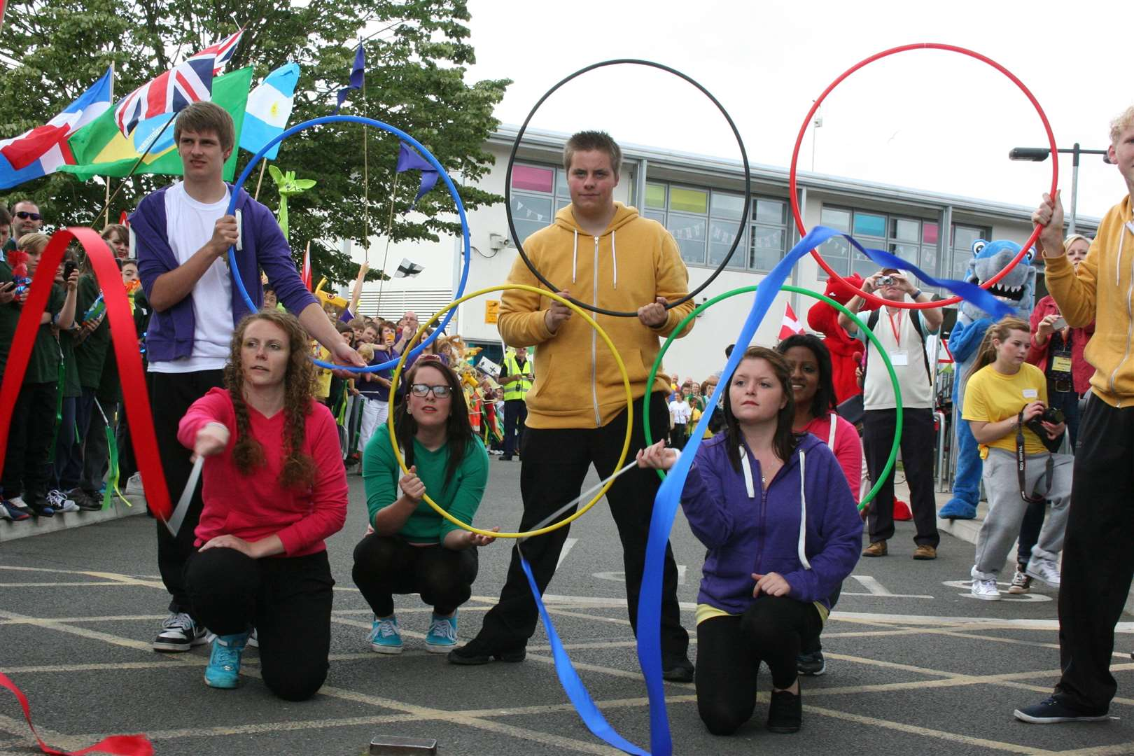 A colourful display. Waiting to greet the arrival of the flame at Ashford's North School. Pic: Mary Louis