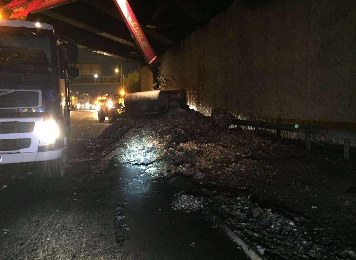 Debris being cleared from the road. Picture: Highways England