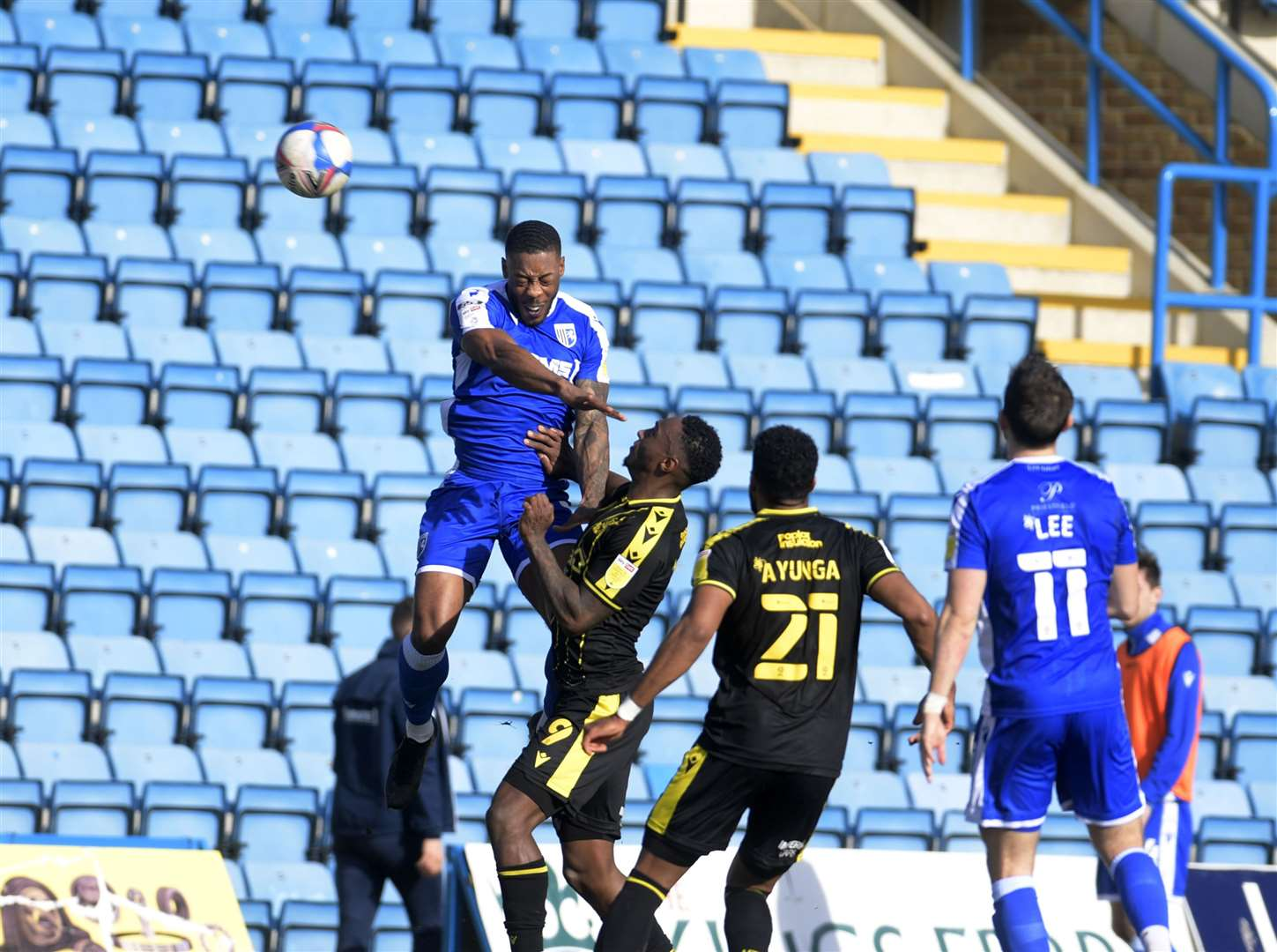 Gillingham defender Ryan Jackson wins the ball in the air Picture: Barry Goodwin